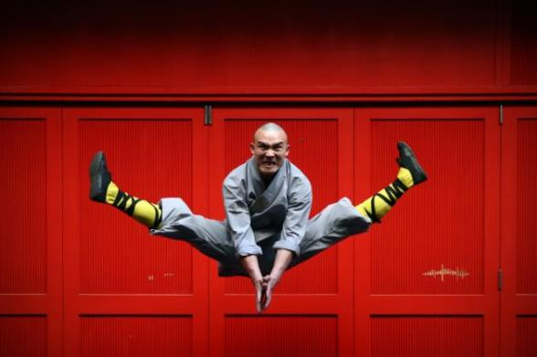 A Shaolin monk poses for a photograph in Chinatown on February 23, 2015 in London, England. The monks practice Shaolin Kung Fu which is believed to be the oldest institutionalised style of kung fu and are demonstrating their skills while in the UK. (Carl Court/Getty Images)
